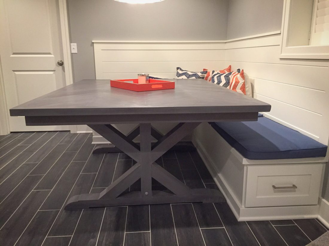 Custom chevron style dining table with x trestle legs