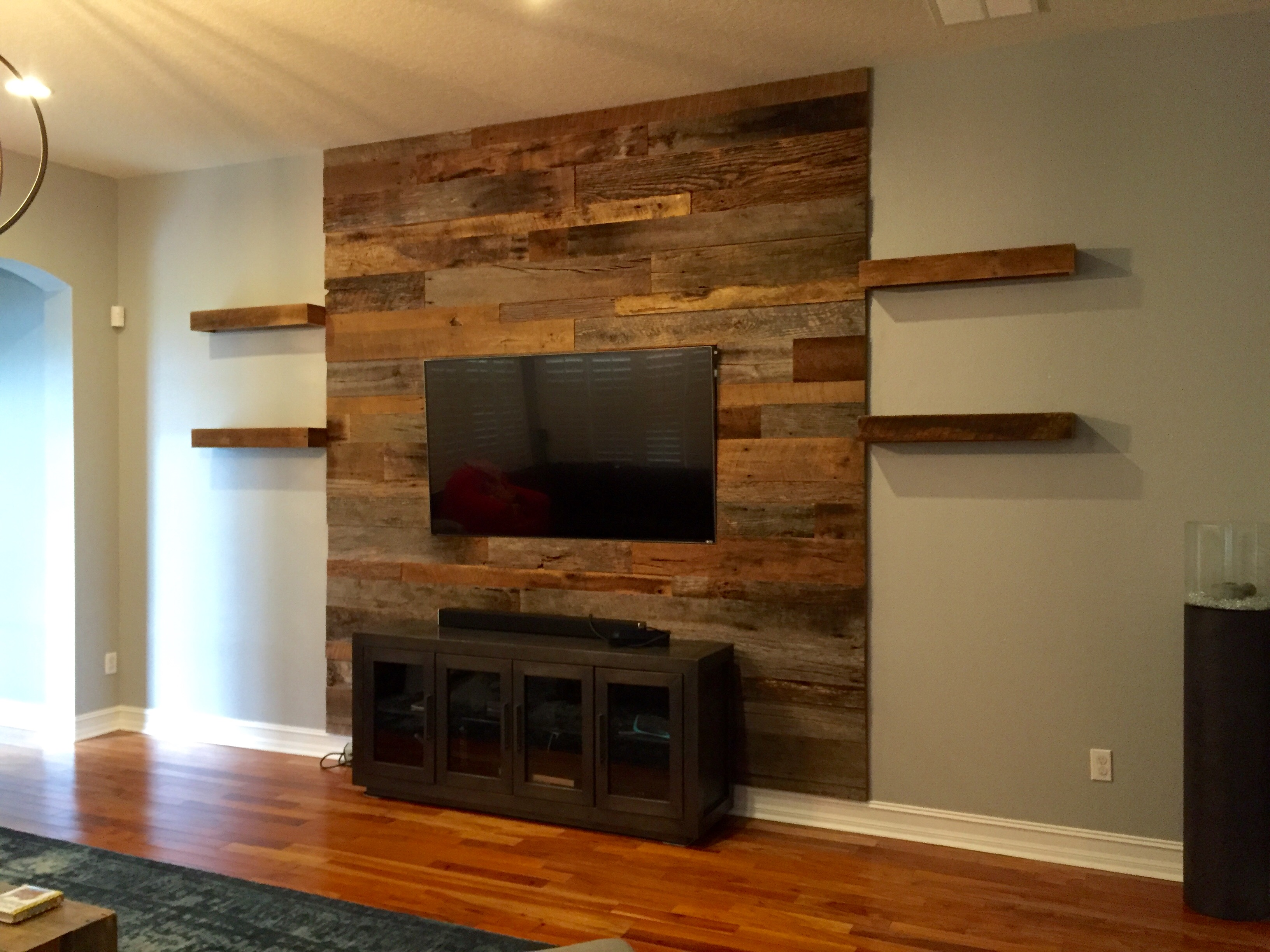 Reclaimed wood wall living room - Trevor S Reclaimed Barn Wood Accent Wall With Shelving