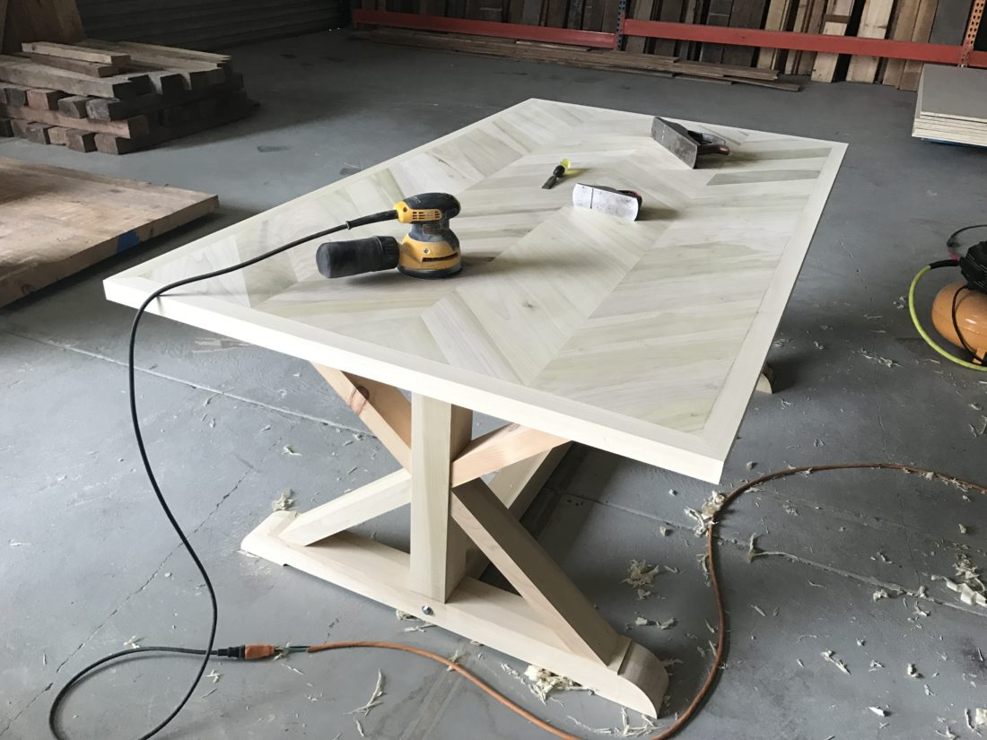 chevron table with trestle base