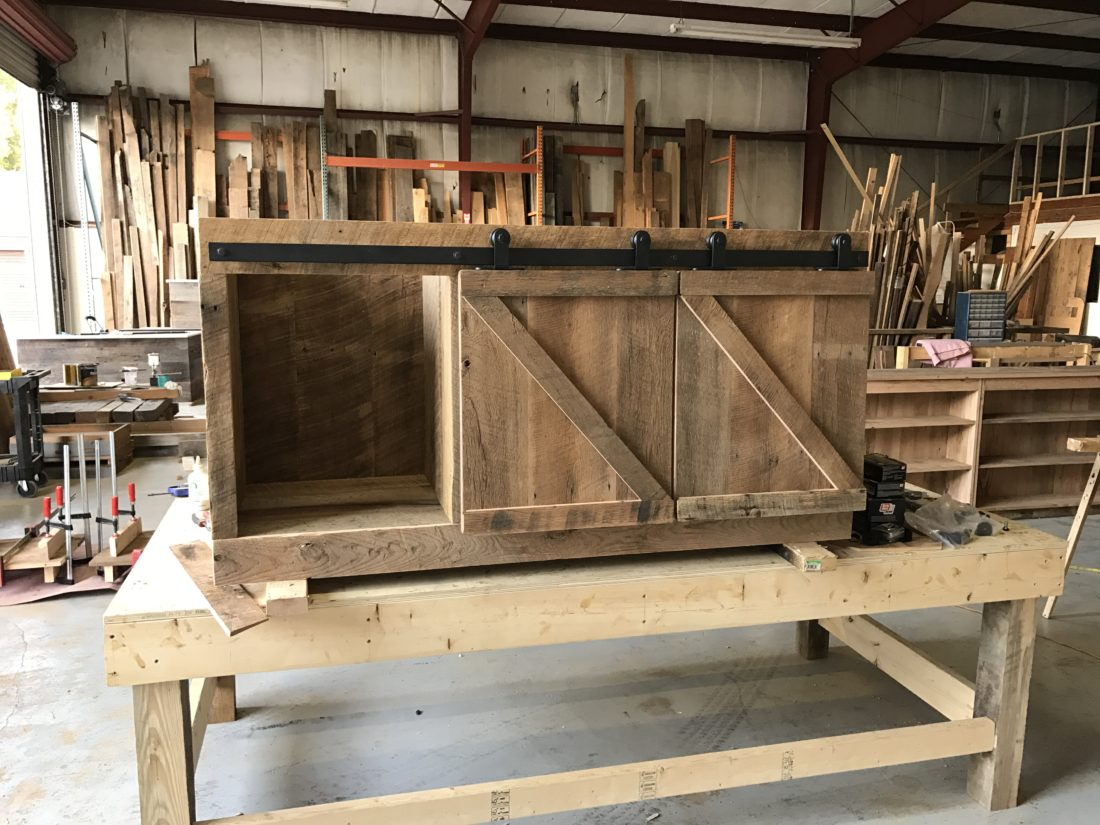 reclaimed wood media cabinet with z pattern barn doors